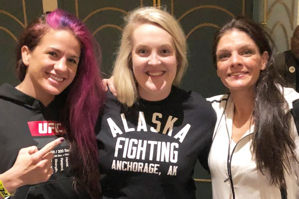 Anchorage fighter Lauren Murphy (right) poses with Gina Mazany (left) and Sarah Lorimer (center) after her UFC victory Friday in UFC victory in Las Vegas. Mazany is a fellow UFC fighter from Anchorage who recently won a fight in China and Lorimer is the owner of the Alaska Fighting Championship, which helped Murphy and Mazany get their start in the sport. (Courtesy Sarah Lorimer)