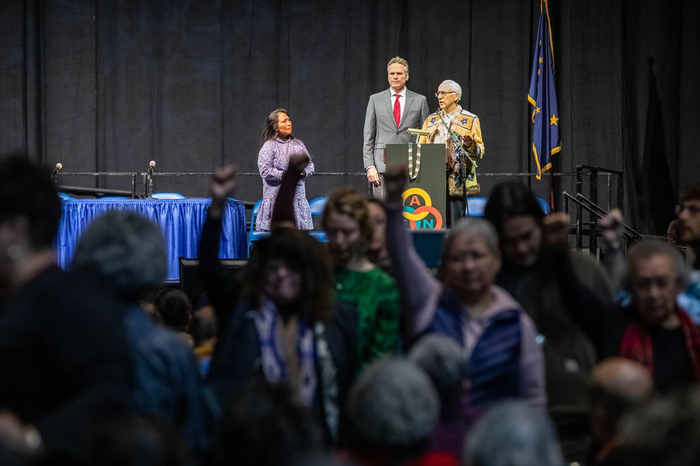 Alaska Federation of Natives co-chairman Will Mayo steps in to quiet a protest during Alaska Gov. Mike Dunleavy's address. (Loren Holmes / ADN)