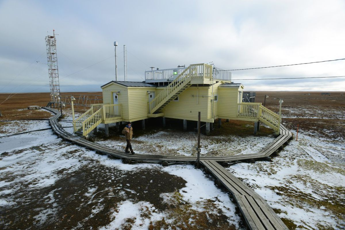 Technician Ross Burgener staffs the NOAA Global Monitoring Division Barrow Observatory on September 21, 2015, about 5 milesoutside of town. Three vertical intakes behind the structure, back left, capture air samples for analysis. The site also hosts short-term research projects from around the world. (Erik Hill / Alaska Dispatch News)