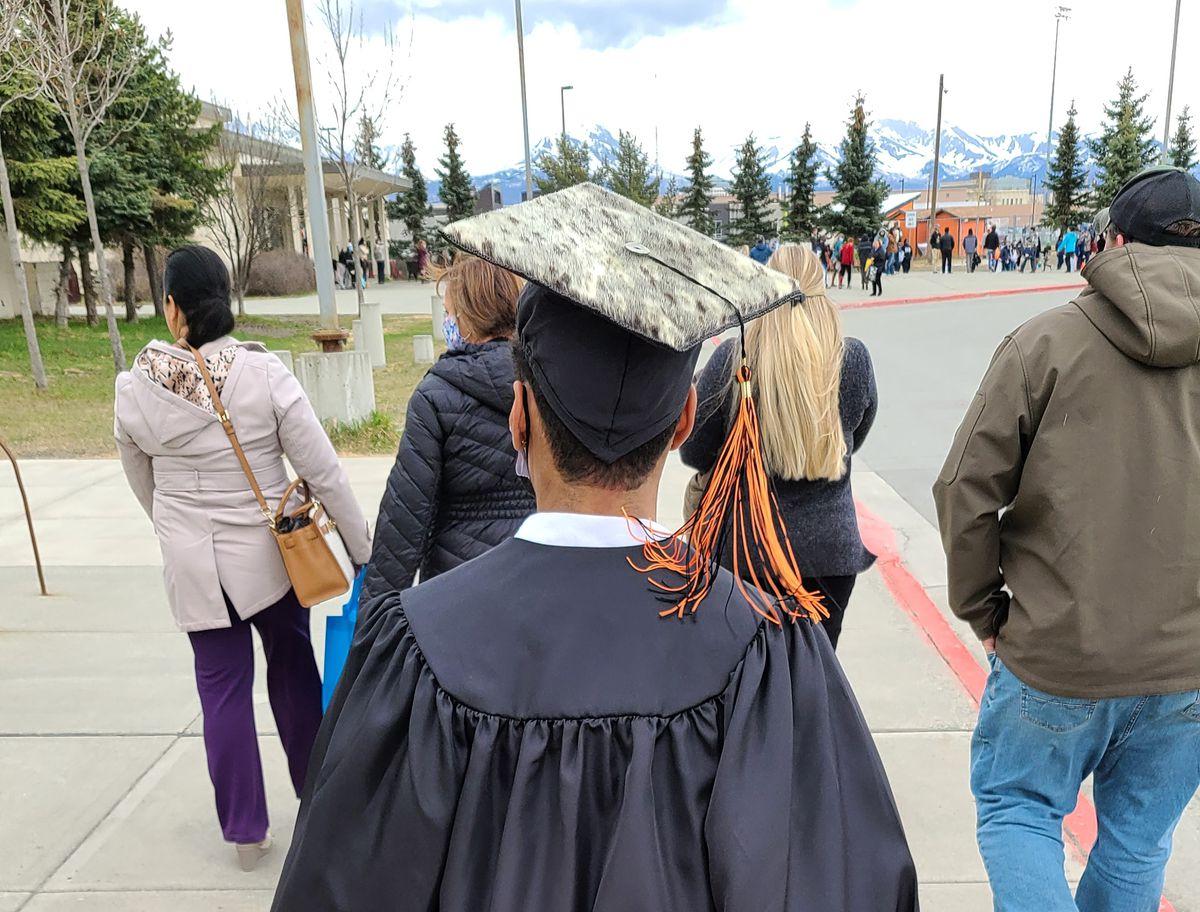2021 West High School graduate David Paoli walks while wearing his sealskin graduation cap. (Ayyu Qassataq photo)