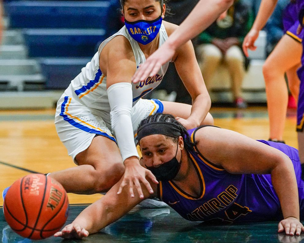 Lathrop's Marie Oliver, right, and Bartlett's Amelia Uhila reach for the ball. (Loren Holmes / ADN)