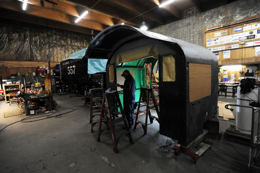Terry Douglas prepares the Engine 557 cab for painting. (Erik Hill / Alaska Dispatch News)