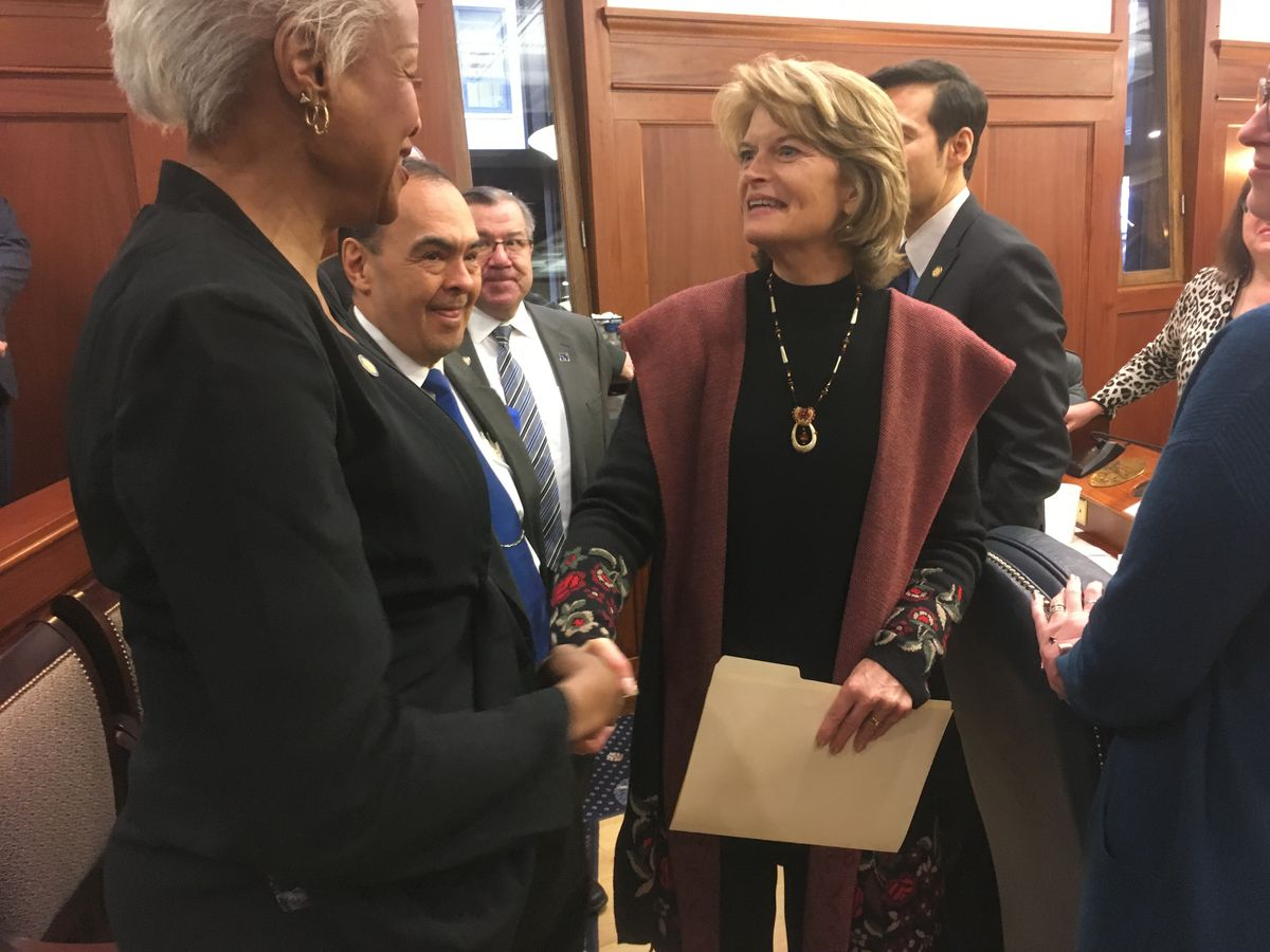 U.S. Sen. Lisa Murkowski shakes the hand of state Sen. Elvi Gray-Jackson, D-Anchorage, after Murkowski's annual address to the Alaska Legislature on Tuesday, Feb. 19, 2019 in the Alaska Capitol. (James Brooks / ADN)