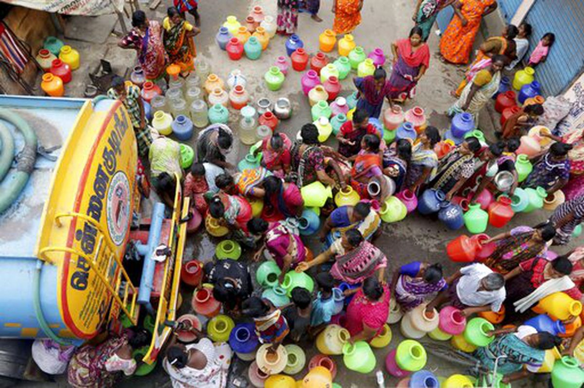 In this Wednesday, June 19, 2019, file photo, Indians stand in queues to fill vessels filled with drinking water from a water tanker in Chennai, capital of the southern Indian state of Tamil Nadu. Millions of people are turning to water tank trucks in the state as house and hotel taps run dry in an acute water shortage caused by drying lakes and depleted groundwater. Some private companies have asked employees to work from home and several restaurants are closing early and even considering stopping lunch meals if the water scarcity aggravates. (AP Photo/R. Parthibhan, File)