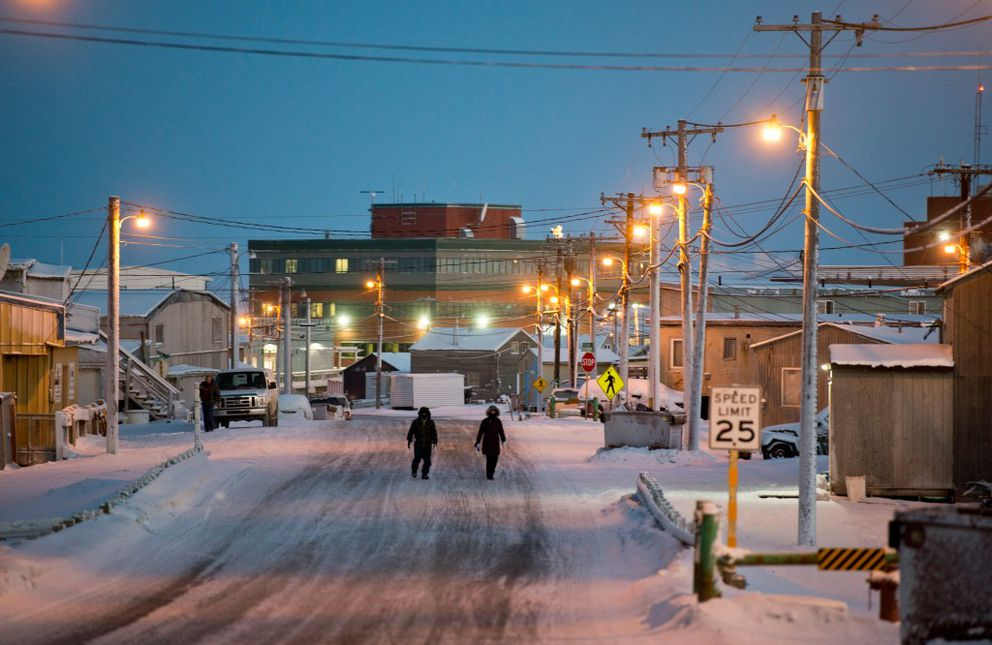 People walk on Stevenson Street in Utqiagvik on Dec. 13. Voters approved changing the name of the city of Barrow to Utqiagvik in October. (Marc Lester / Alaska Dispatch News)