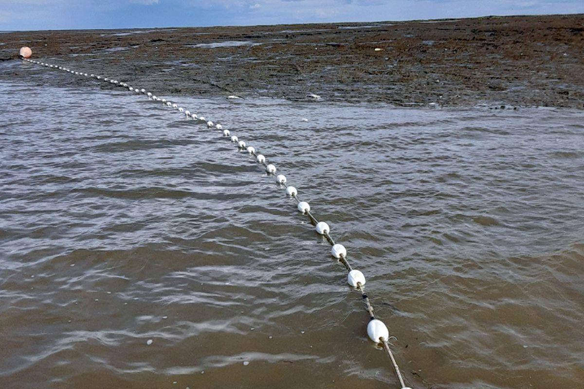 A setnet stretches across the water at Bristol Bay. (Photo by John Schandelmeier)