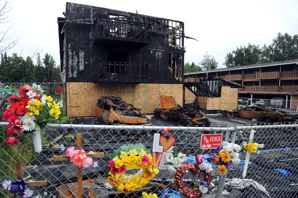 Memorials are maintained, but otherwise a Royal Suite Apartments building appears much as it did following a February fire that killed three residents on Friday, July 28, 2017, along Minnesota Drive just south of Spenard Road. (Erik Hill /ADN)