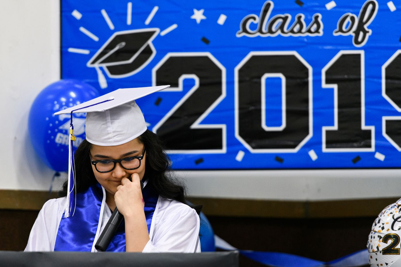 Denise Kalmakoff pauses while delivering her graduation speech on May 16. Kalmakoff thanked her mother and the school's small staff during the speech. (Marc Lester / ADN)