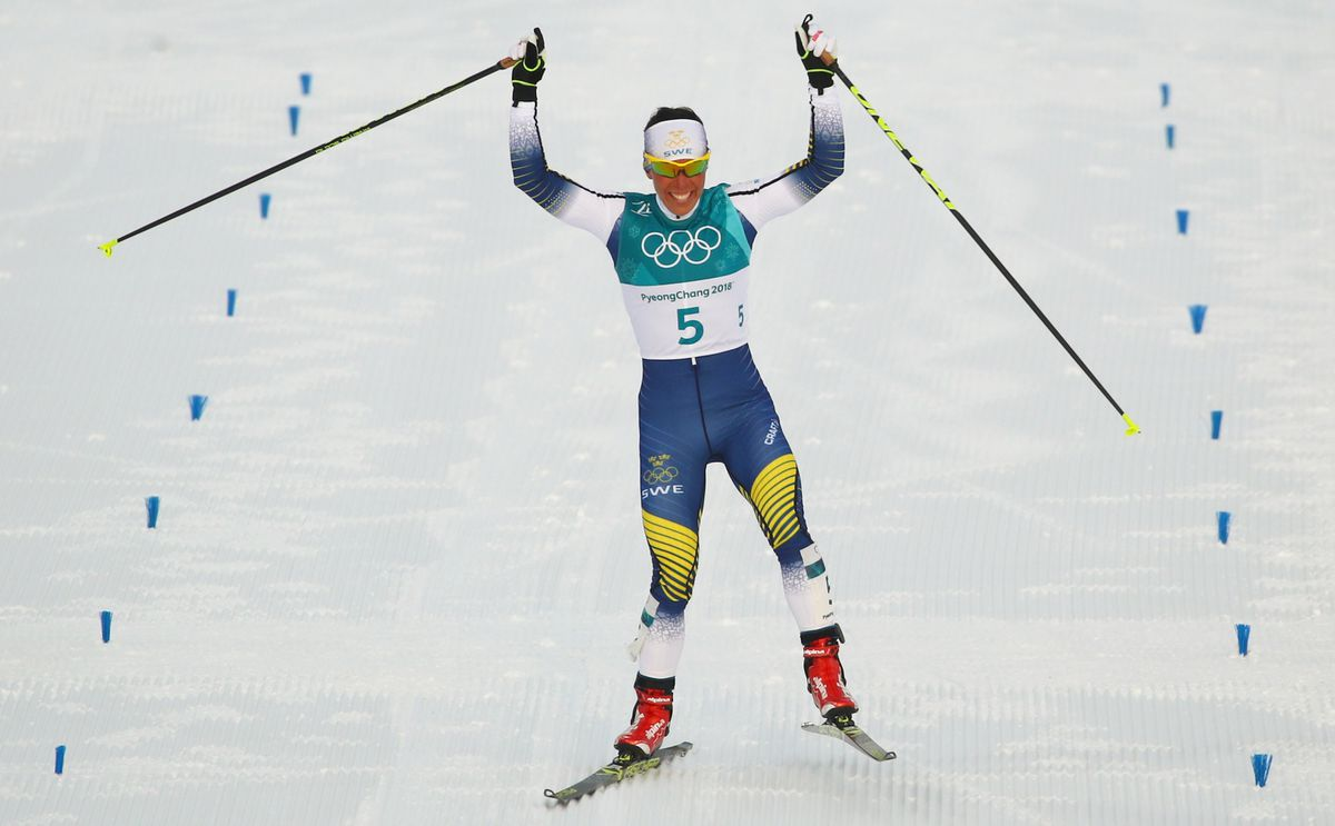 Charlotte Kalla of Sweden celebrates after winning the 7.5km + 7.5km Skiathlon. REUTERS/Carlos Barria