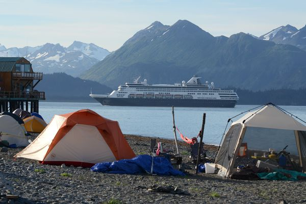Holland America's cruiseship Maasdam makes a port call in Homer on Aug. 9, 2016. Camping on the beach of the spit is popular among visitors and workers alike. (Anne Raup / Alaska Dispatch News)