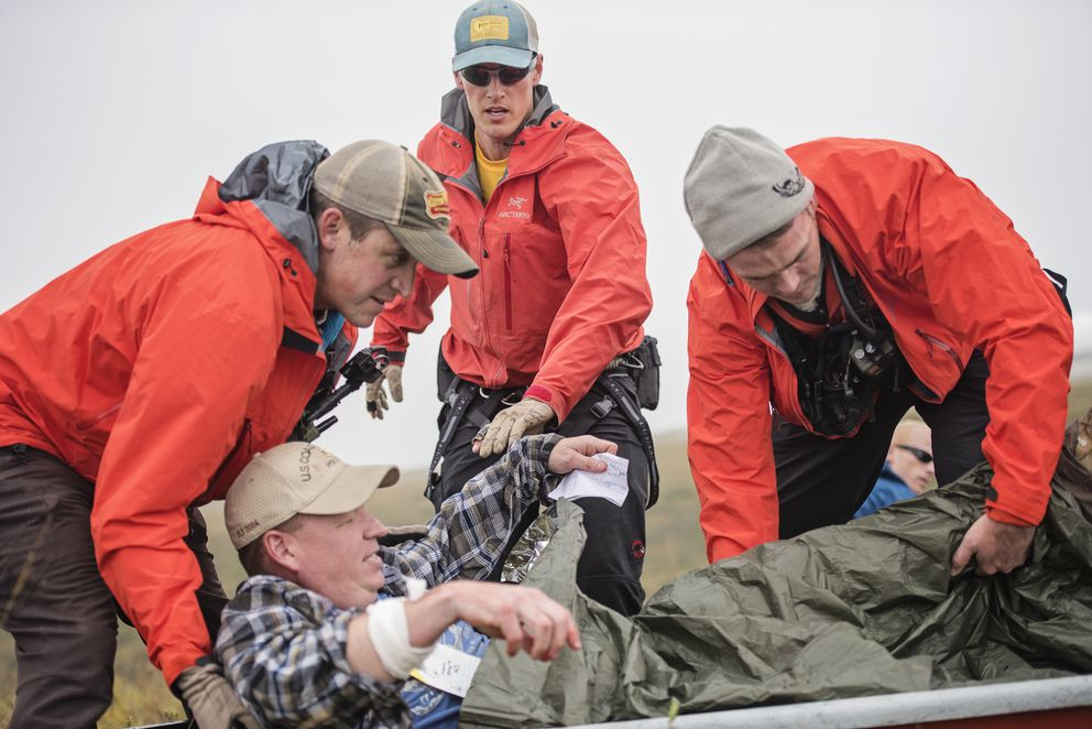 A Guardian Angel team from the 212th Rescue Squadron, Alaska Air National Guard, prepare to transfer a simulated casualty to their Arctic Sustainment Package for treatment during exercise Arctic Chinook, near Kotzebue, Alaska, August 23. (Staff Sgt. Edward Eagerton / U.S. Air National Guard)