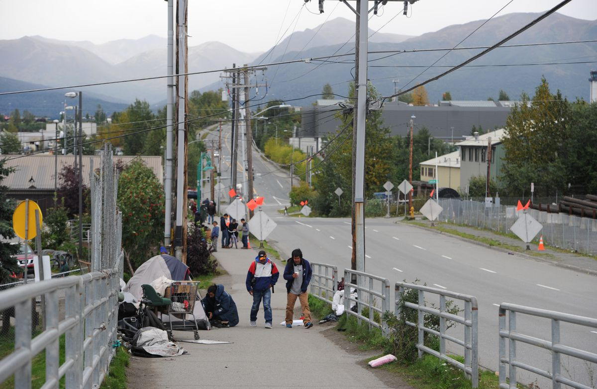 Pedestrians walk along East Third Avenue near the Brother Francis Shelter on Wednesday. (Bill Roth / Alaska Dispatch News)