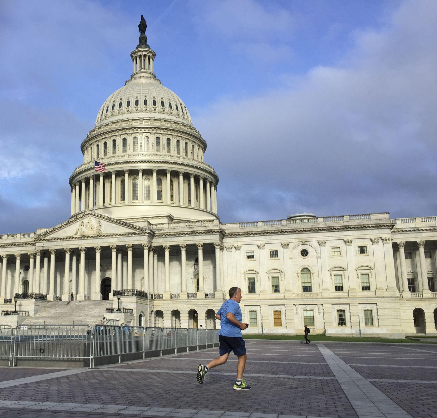 Sen. Dan Sullivan passes the U.S. Capitol on a morning run in Washington, D.C., on June 19, 2019. (Marc Lester / ADN)