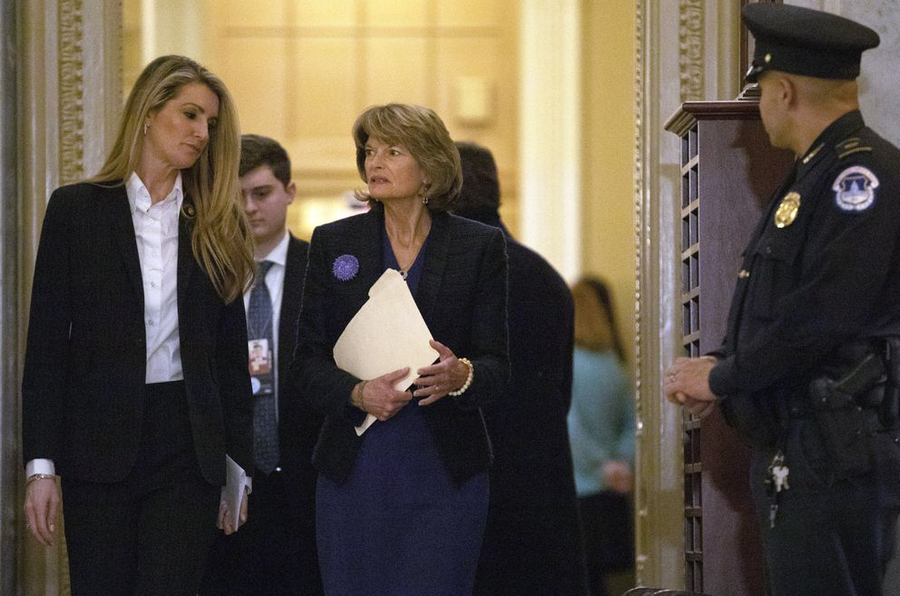 Sen. Kelly Loeffler, R-Ga., left, and Sen. Lisa Murkowski, R-Alaska, walk on Capitol Hill in Washington, Thursday, Jan. 30, 2020, as they return to the Senate chamber after a break in the impeachment trial of President Donald Trump on charges of abuse of power and obstruction of Congress. (AP Photo/ Jacquelyn Martin)