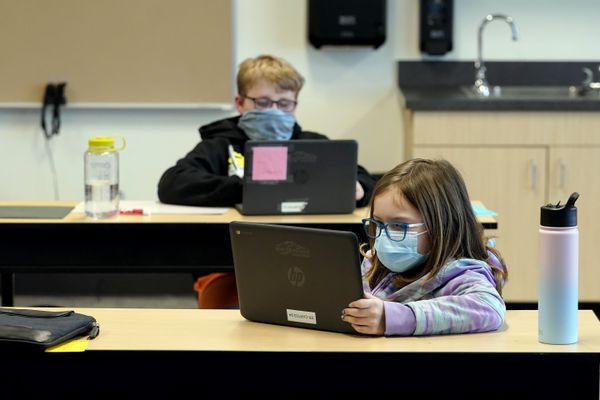 FILE - In this Feb. 2, 2021, file photo, students wear masks as they work in a fourth-grade classroom, at Elk Ridge Elementary School in Buckley, Wash. Amid mounting tensions about school reopening, the Centers for Disease Control and Prevention planned to release long-awaited guidance Friday, Feb. 12, 2021, on what measures are needed to get children back into the classroom during the pandemic. (AP Photo/Ted S. Warren, File)