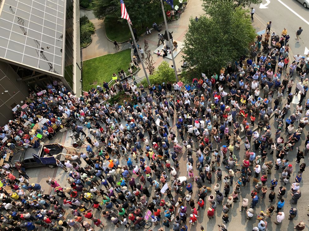 A protest rally urging the Alaska Legislature to override Gov. Mike Dunleavy's decision to veto $444 million from the state operating budget is seen from the fifth floor of the Alaska Capitol on Monday, July 8, 2019. (James Brooks / ADN)