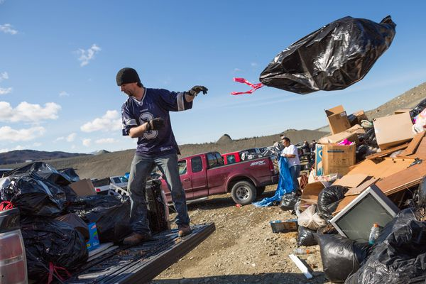 Anchorage resident Rick Teel unloads a pickup truck full of trash at the Anchorage landfill on the first of two free dump days, on Saturday, May 2, 2015. Approximately 5,000 loads are expected this year over the two days. (Loren Holmes / ADN archive)