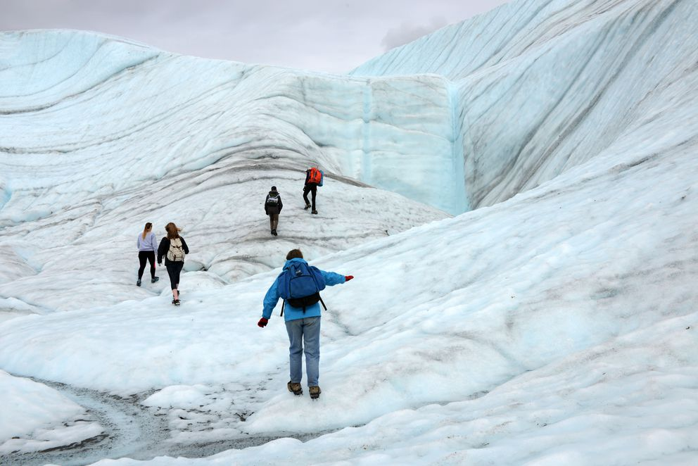 Guided visitors explore Root Glacier in 2015, near Kennecott. The glacier joins the Kennicott Glacier near the Kennecott Mine site in Wrangell St. Elias National Park and Preserve. (Erik Hill / ADN)