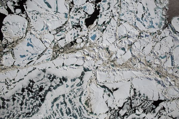 A handout aerial photo from NASA of sea ice, melt ponds and areas of open water in the Chukchi Sea of the Arctic Ocean, July 16, 2016. A spate of extreme warmth in the Arctic over the past two months has startled scientists: In mid-November, parts of the Arctic were more than 35 degrees Fahrenheit warmer than observed averages, scientists said, and at the pole itself, mean temperatures for the month were 23 degrees above normal. (NASA via The New York Times)