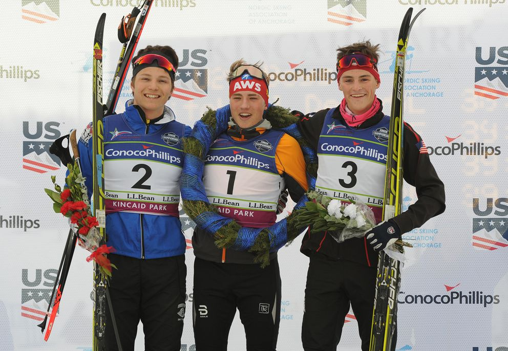 Gus Schumacher, center, returns the top spot on the U20 men's podium after winning Friday's race. JC Schoonmaker, left, was second, and Cameron Wolfe, right, was third. (Photo by Michael Dinneen)