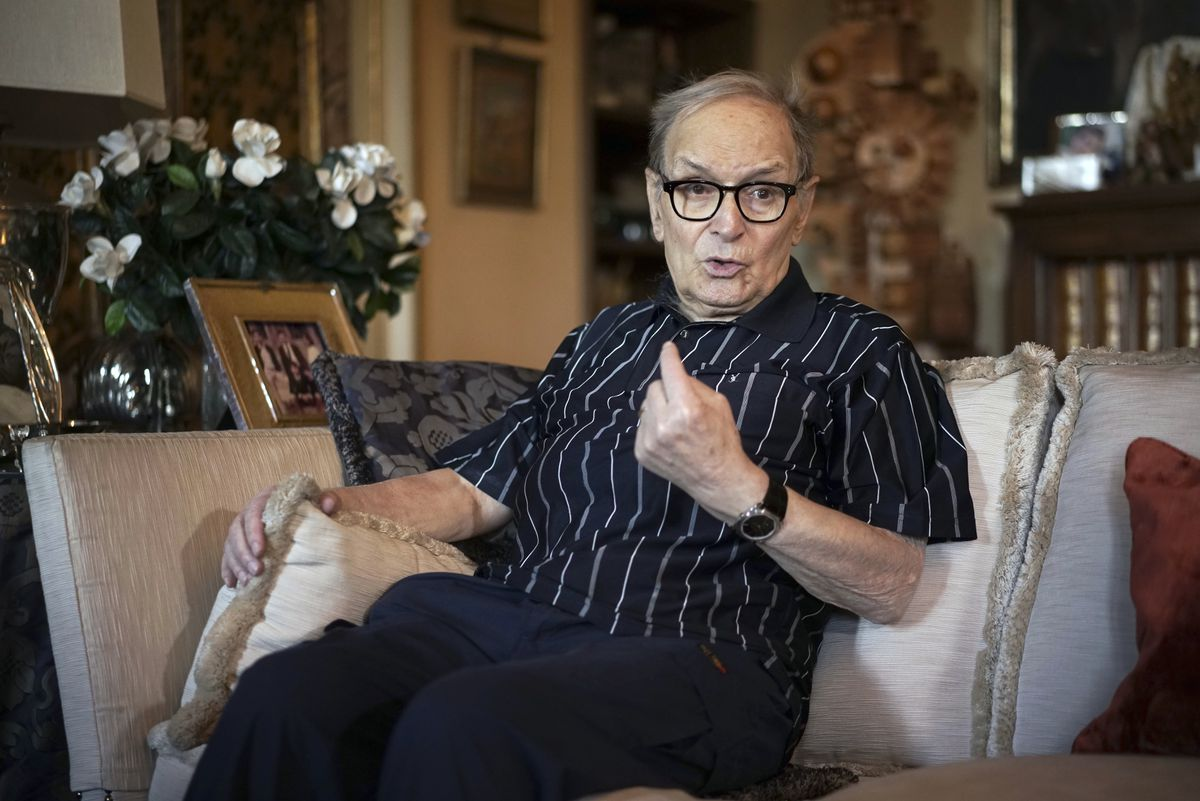 """FILE - In this May 31, 2016 file photo, three-time best sound-track Oscar winner Ennio Morricone answers questions during an interview with The Associated Press, in Rome. Morricone, who created the coyote-howl theme for the iconic Spaghetti Western """"The Good, the Bad and the Ugly"""" and the soundtracks such classic Hollywood gangster movies as """"The Untouchables,"""" died Monday, July 6, 2020 in a Rome hospital at the age of 91. (AP Photo/Andrew Medichini, file)"""