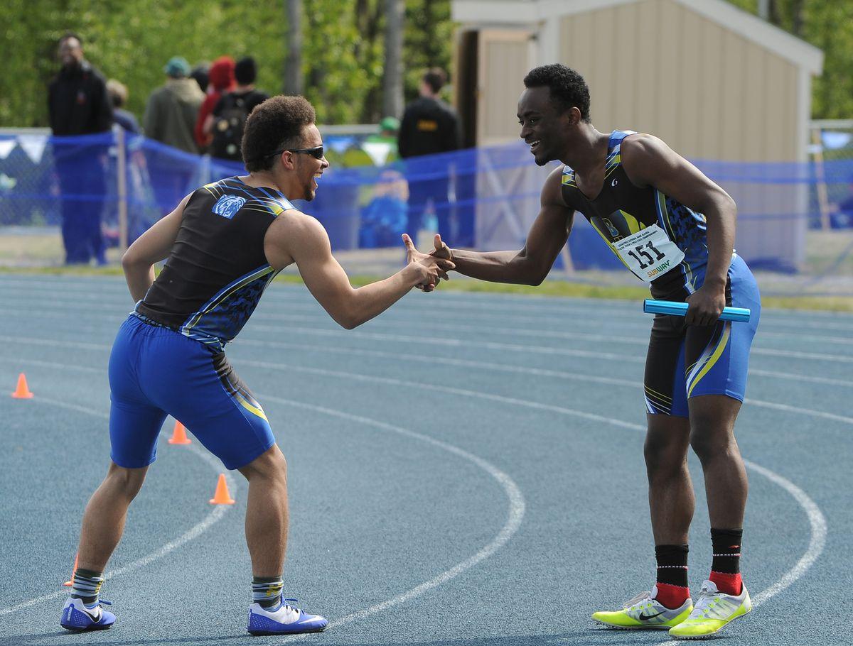 Jaylen Wilson and Treyone Suber of Bartlett celebrate their 800-meter relay win Saturday. (Bob Hallinen / ADN)