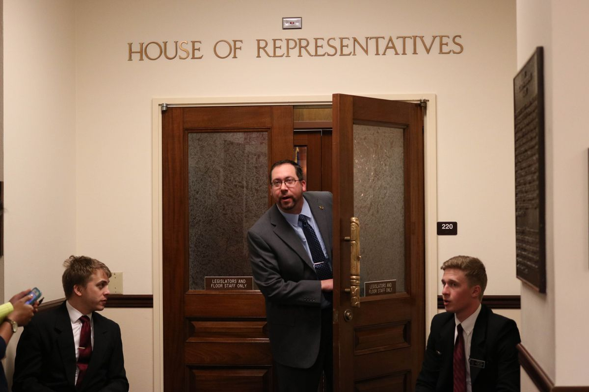 Bethel Democratic Rep. Zach Fansler pokes his head out from the floor of the Alaska House earlier this year. (Nathaniel Herz / ADN)