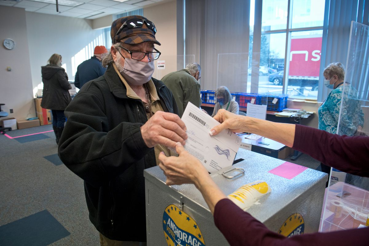 Tony Lofaso casts his ballot at the in-person voting location at City Hall in Anchorage on April 5, 2021. (Marc Lester / ADN)