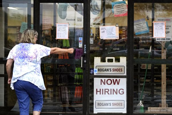 A hiring sign is displayed outside a retail store in Buffalo Grove, Ill., Thursday, June 24, 2021. The number of Americans applying for unemployment benefits has reached its lowest level since the pandemic struck last year, further evidence that the U.S. economy and job market are quickly rebounding from the pandemic recession. The report from the Labor Department released Thursday, July 15 showed that jobless claims fell by 26,000 last week to 360,000. (AP Photo/Nam Y. Huh)