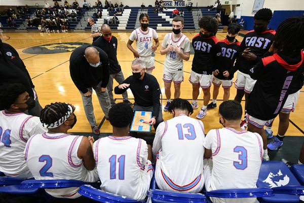 East High head coach talks to his players during the Thunderbirds' 56-42 victory over the Wolverines in the quarterfinals of the 4A boys state basketball tournament at Palmer High School on Thursday, March 25, 2021. (Bill Roth / ADN)