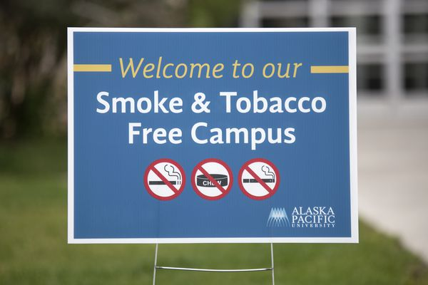 Signs indicating a smoke and tobacco free campus are found around Alaska Pacific University Monday, August 14, 2017, in Anchorage. (Rugile Kaladyte / Alaska Dispatch News)