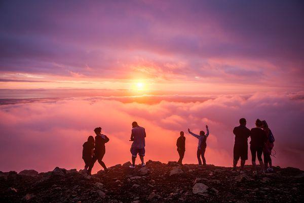 The annual summer solstice celebration atop Flattop mountain in Anchorage, Alaska. Flattop is Alaska's most-climbed peak. June 20, 2012.