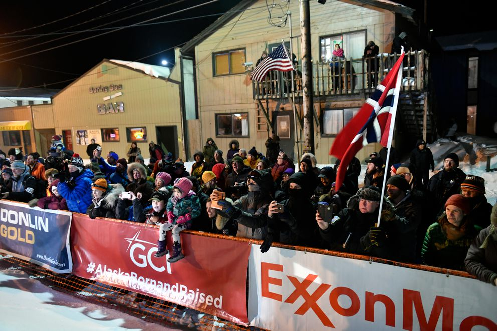 A crowd watches on Front Street in Nome. Thomas Waerner of Norway arrived in Nome to win early March 18, 2020, to win the Iditarod Trail Sled Dog Race. (Marc Lester / ADN)
