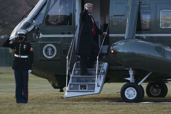 President Donald Trump and first lady Melania Trump board Marine One as they depart the White House on Jan. 20, 2021. (Eric Thayer/Getty Images/TNS)
