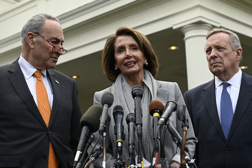 House Speaker Nancy Pelosi of Calif., center, standing with Senate Minority Leader Sen. Chuck Schumer of N.Y., left, and Sen. Dick Durbin, D-Ill., right, speak with reporters following their meeting with President Donald Trump at the White House in Washington, Wednesday, Jan. 9, 2019. (AP Photo/Susan Walsh)