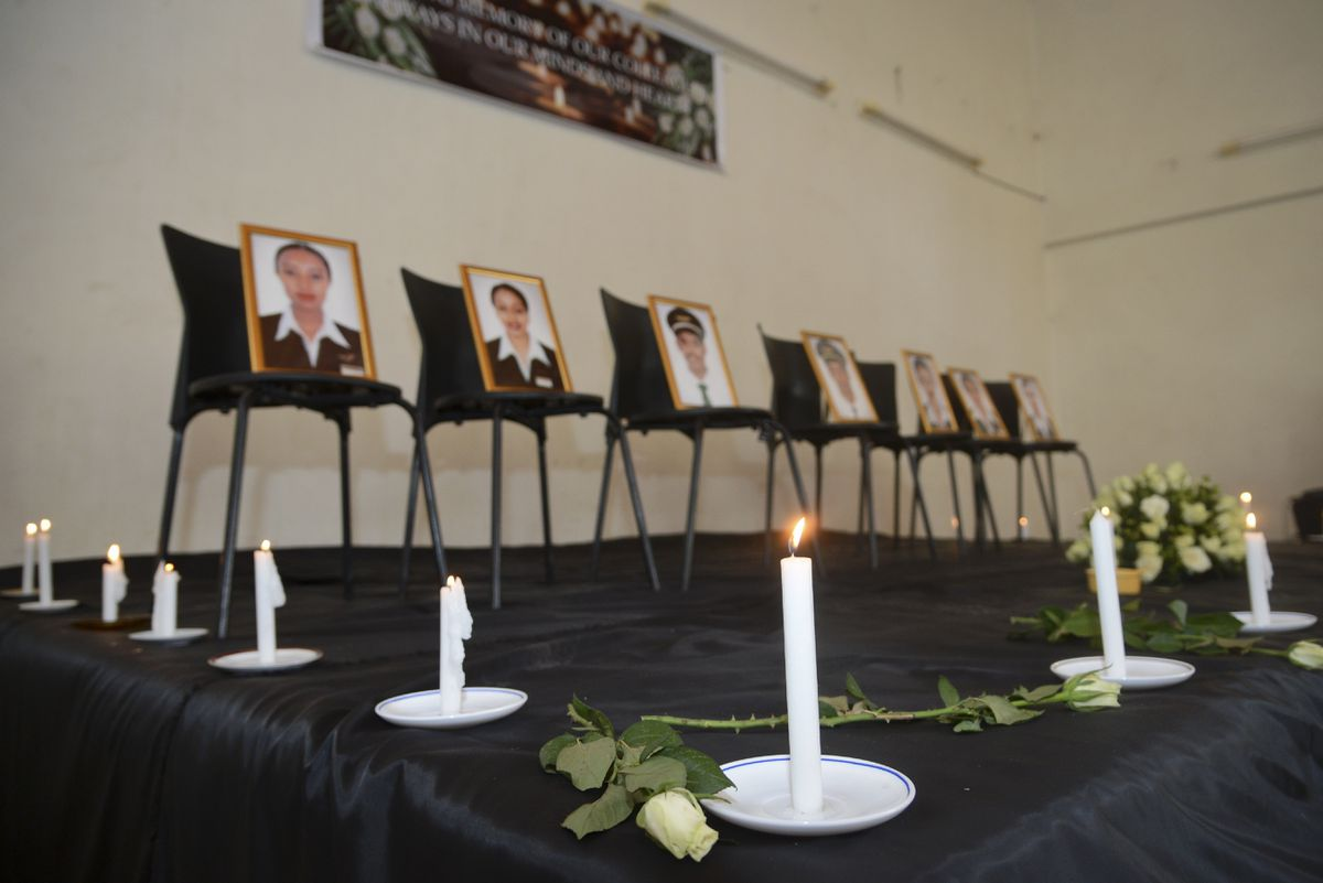 Framed photographs of seven crew members are displayed at a memorial service held by an association of Ethiopian airline pilots, in Addis Ababa, Ethiopia Monday, March 11, 2019. Authorities in Ethiopia, China and Indonesia grounded all Boeing 737 Max 8 aircraft Monday following the crash of an Ethiopian Airlines jetliner that killed 157 people, and investigators found the flight recorders from the field where the plane went down. (AP Photo/Samuel Habtab)