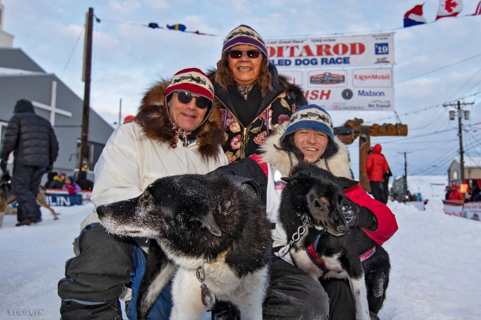 Ketil Reitan, Evelyn Anguyak Reitan and Martin Apayauq Reitan with Apok (left) and Kent (right) at the end of 2019 Iditarod Trail Sled Dog Race in Nome. (Photo by Ari Sigglin)