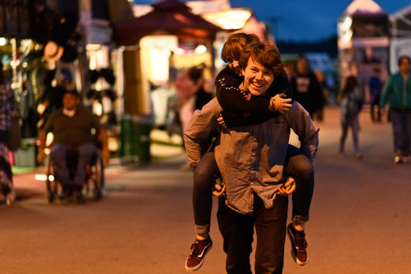 Nathan Power carries Emily Gibson shortly before closing time. (Marc Lester / ADN)