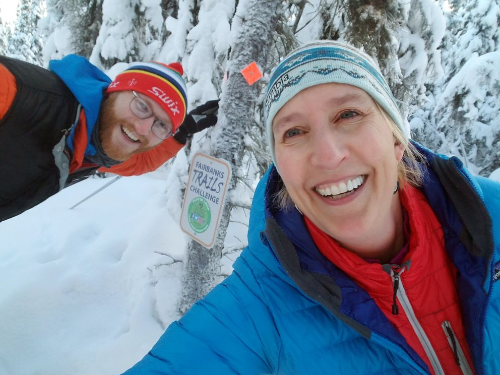 Erin Kirkland, right, takes a selfie with Bryant Wright, trails coordinator for the Fairbanks North Star Borough Parks and Recreation Department, along Puffin Loop of the Pearl Creek trail system, number 9 of 10 trails in the Fairbanks challenge. (Erin Kirkland)
