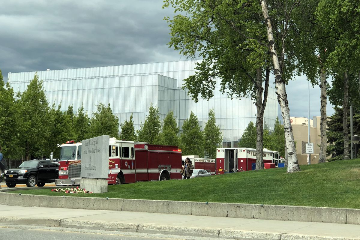 Anchorage Fire Department personnel respond to a hazmat incident at the Federal Building in Anchorage on Tuesday. (Loren Holmes / ADN)