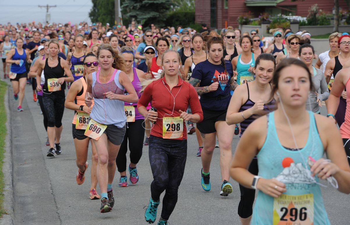 Runners leave the start of the women's-only Her Tern Half and Quarter Marathons at Delaney Park Strip on Sunday. (Bill Roth / Alaska Dispatch News)