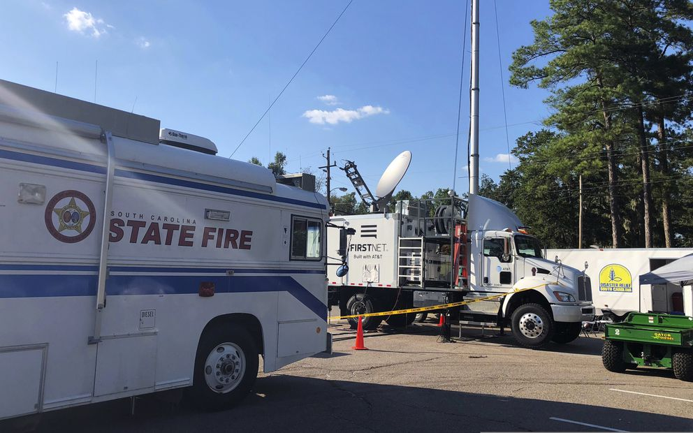 This Sept. 19, 2018, photo provided by AT&T shows equipment, center, that turns a satellite signal into an LTE cell tower that was used during Hurricane Florence in Marion, South Carolina. The equipment is a supplementary part of FirstNet, a new national wireless network dedicated for first responders. (AT&T via AP)