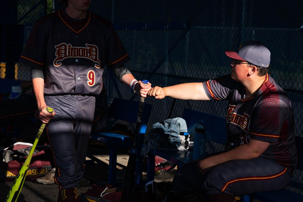 Dimond's Joe Moriarity gets a fist bump from teammate Eric Galosica during a game against Bartlett on Friday, June 12, 2020 at Bartlett. With American Legion baseball cancelled this year, a group called the Alliance for the Support of American Legion Baseball in Alaska has stepped in to fill the void. (Loren Holmes / ADN)