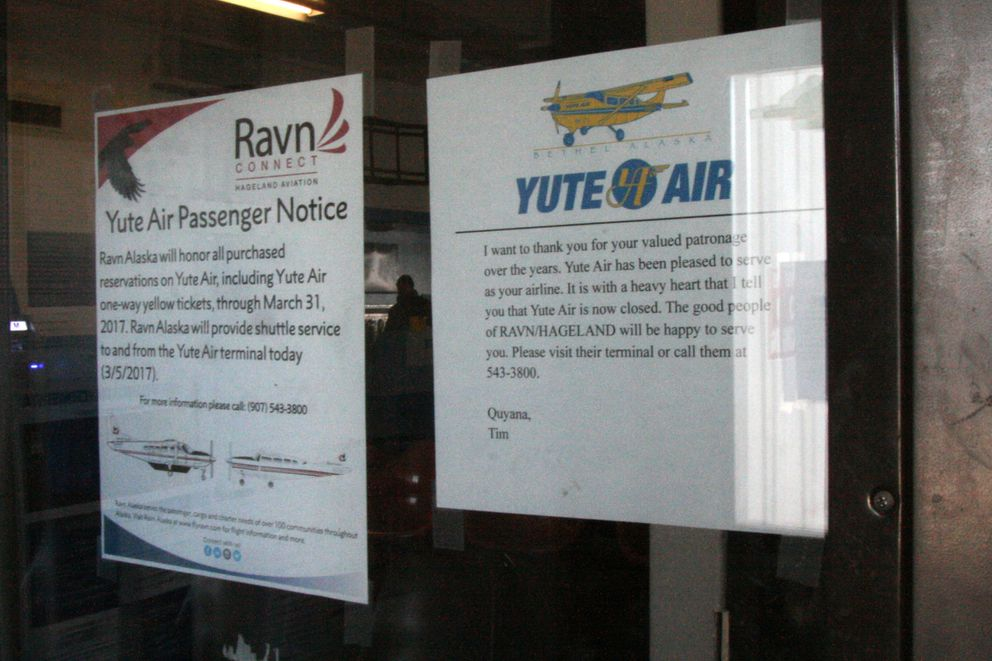 Notices at what used to be the passenger entrance to Yute Air are seen on Monday. (Lisa Demer / Alaska Dispatch News)