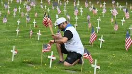 Veterans and volunteers decorate Anchorage gravesites for Memorial Day
