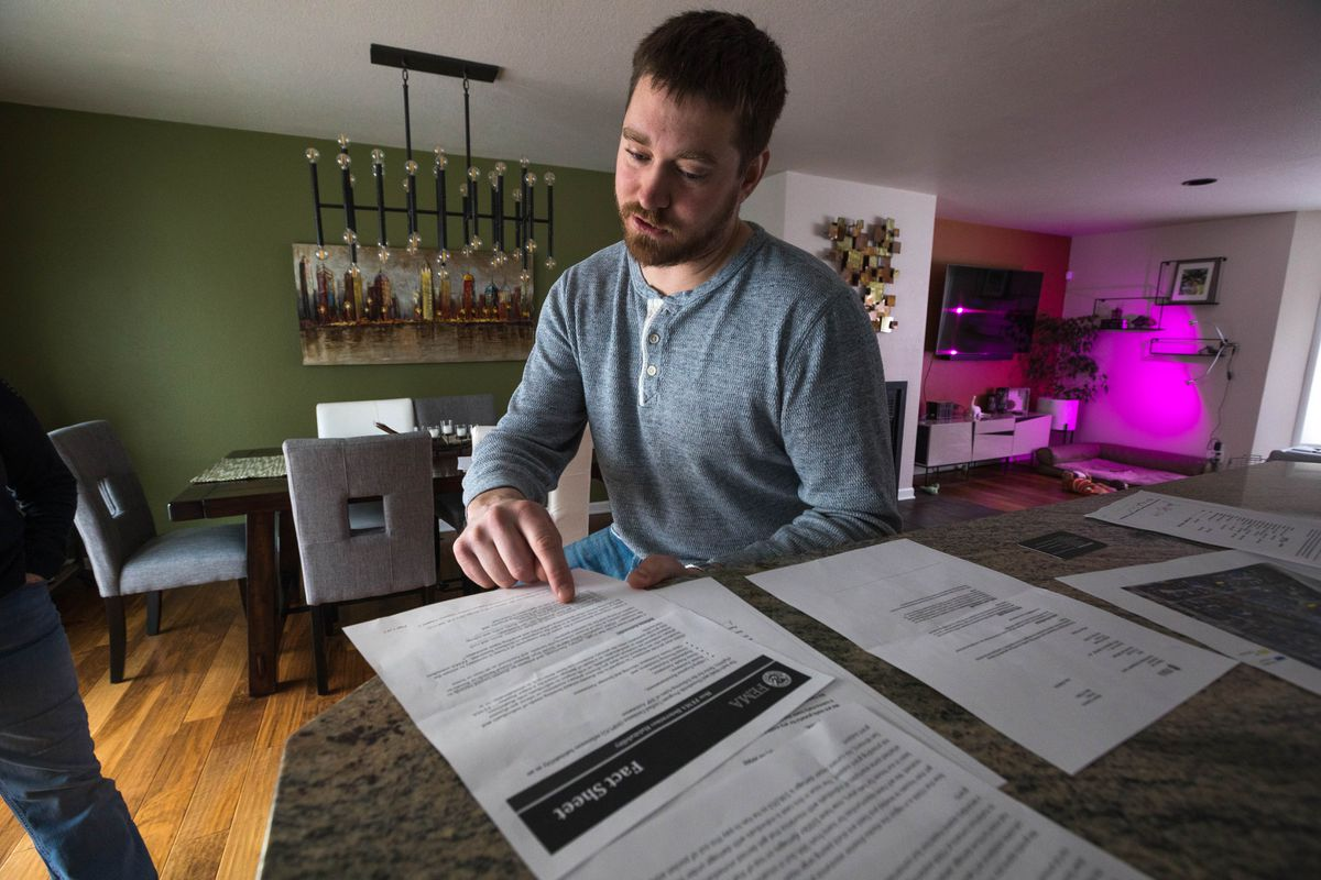Ryan Manzek points to documents relating to his FEMA appeal on Friday, March 1, 2019. Manzek's Sand Lake home was badly damaged during the Nov. 30 earthquake. (Loren Holmes / ADN)