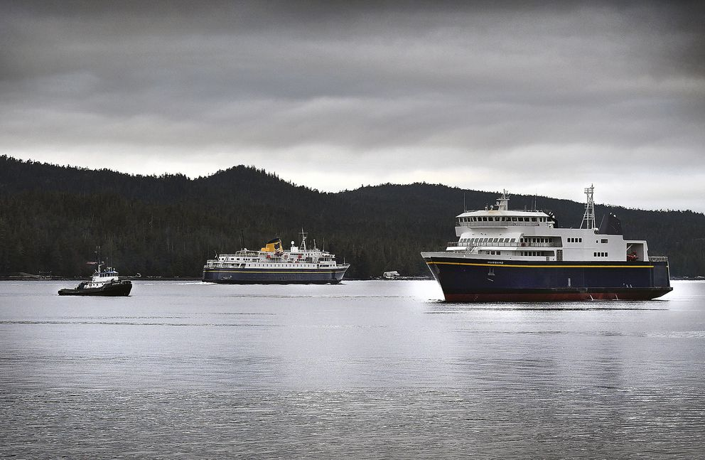 In this Tuesday, Dec. 4, 2018 photo, the new Alaska Marine Highway System ferry Hubbard, right, undergoes sea trials in the view of the AMHS ferry Malaspina, center, in the Tongass Narrows near Ketchikan. (Dustin Safranek/Ketchikan Daily News via AP)