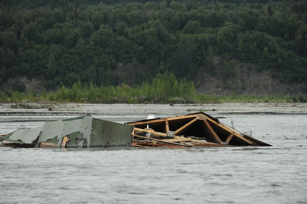 The roof from a building is caught on a gravel bar in the Matanuska River near Sutton. (Bob Hallinen / Alaska Dispatch News)