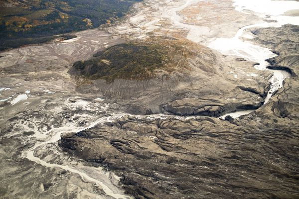 A stream flows through the toe of Kaskawulsh glacier in Canada. In 2016, this channel allowed the glacier's meltwater to drain in a different direction than normal, resulting in the Slims River water being rerouted to a different river system. MUST CREDIT: Dan Shugar.
