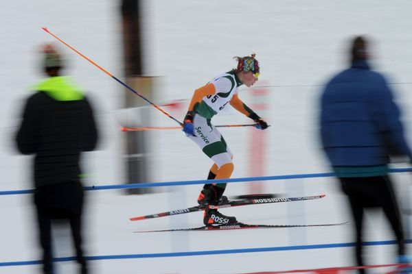 Gus Schumacher, of Service High, skis through the stadium in the second leg during the CIC Cross Country Ski Championship relays at Kincaid Park in Anchorage, Alaska on Saturday, Feb. 18, 2017. (Bob Hallinen / Alaska Dispatch News)